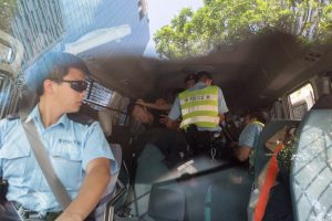 Inside and outside the police car. Kyle Lam of HK01